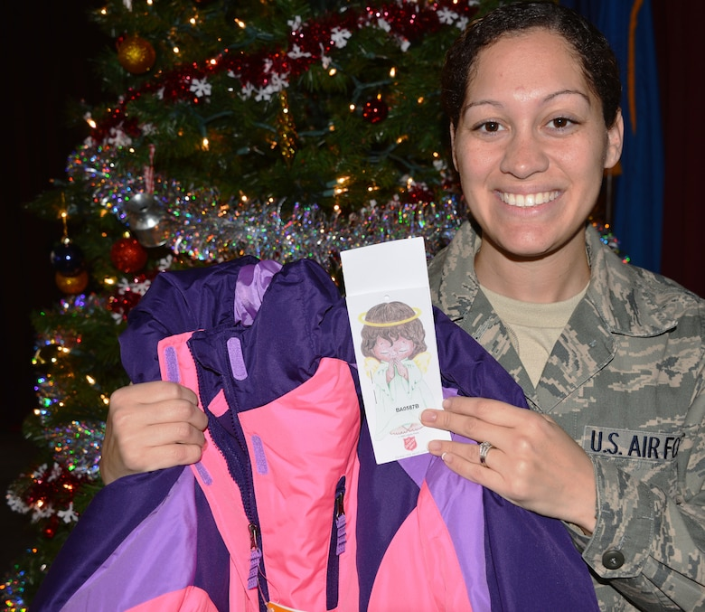 Tech. Sgt. Ashley Mooney, functional systems manager with the 175th Logistics Readiness Squadron, stands with one of many gifts for the Angel Tree. Maryland Air National Guard members contributed to a Salvation Army program to help less fortunate families. (National Guard photo by Tech. Sgt. David Speicher)