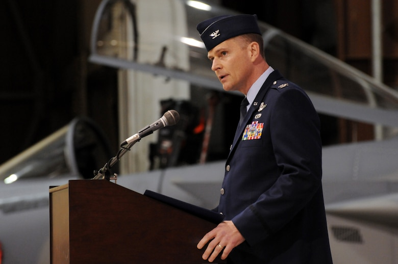 Oregon Air National Guard Col. Richard Wedan addresses attendees at the 142nd Fighter Wing Change of Command ceremony, held at the Portland Air National Guard Base in Portland, Ore., Dec. 2. Wedan assumes command from Col. Michael E. Stencel, who had commanded the Wing for the past three years. (U.S. Air Force photo by Tech. Sgt. John Hughel, 142nd Fighter Wing Public Affairs / released.)
