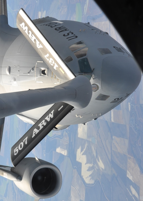 A 465th Air Refueling Squadron crew refuels a Mississippi Air National Guard C-17 Globemaster from the 172nd Airlift Wing over the skies of Louisiana on November 29. The 465th ARS crew conducted over 45 minutes of refueling with the Mississippi ANG unit. (Photo by Capt. Jon Quinlan)