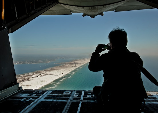 An employer of a 919th Special Operations Wing reservist checks out the view of the Emerald Coast from the back of a MC-130E Combat Talon I during an employer-day tour at Duke Field, Fla. Dec. 1.  The employers attended the tour for a better understanding of how their workers contribute to the Air Force and special operations mission.  (U.S. Air Force photo/Tech. Sgt. Samuel King Jr.)