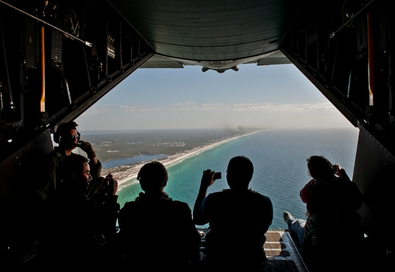 Employers of 919th Special Operations Wing reservists check out the view of the Emerald Coast from the back of a MC-130E Combat Talon I during an employer-day tour at Duke Field, Fla. Dec. 1.  The employers attended the tour for a better understanding of how their workers contribute to the Air Force and special operations mission.  (U.S. Air Force photo/Tech. Sgt. Samuel King Jr.)