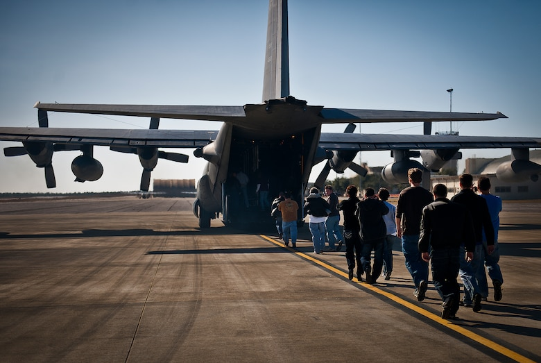 More than 20 employers of 919th Special Operations Wing reservists climb aboard a MC-130E Combat Talon I during an employer-day tour at Duke Field, Fla. Dec. 1.  The employers attended the tour for a better understanding of how their workers contribute to the Air Force and special operations mission.  (U.S. Air Force photo/Tech. Sgt. Samuel King Jr.)