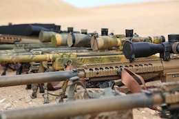 Sniper rifles from Scout Sniper Platoon, Weapons Company, Battalion Landing Team 3/5, 15th Marine Expeditionary Unit were staged at a firing range near Camp Buehring during Exercise Eager Mace 13, Nov. 12, in order to conduct live fire exercises with members of the Kuwait Armed Forces. The U.S. Navy and Marine Corps participated in the bilateral training exercise with the Kuwait Armed Forces Nov. 11-21.  The purpose of the exercise was to expand levels of cooperation, enhance mutual maritime capabilities, as well as promote long-term regional stability and interoperability between U.S. forces and regional partners. The 15th MEU is deployed as part of the Peleliu Amphibious Ready Group as a theater reserve and crisis response force throughout U.S. Central Command and the U.S. 5th Fleet area of responsibility.  (U.S. Marine Corps photo by Cpl. Timothy Childers/Released)