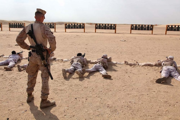 Staff Sgt. Nathan C. Stocking, platoon sergeant, Scout Sniper Platoon, Weapons Company, Battalion Landing Team 3/5, 15th Marine Expeditionary Unit, instructs members of the Kuwait Armed Forces in basic marksmanship techniques at a firing range near Camp Buehring during Exercise Eager Mace 13, Nov. 12. The U.S. Navy and Marine Corps participated in the bilateral training exercise with the Kuwait Armed Forces Nov. 11-21. The purpose of the exercise was to expand levels of cooperation, enhance mutual maritime capabilities, as well as promote long-term regional stability and interoperability between U.S. forces and regional partners. The 15th MEU is deployed as part of the Peleliu Amphibious Ready Group as a theater reserve and crisis response force throughout U.S. Central Command and the U.S. 5th Fleet area of responsibility. Stocking, 29, is from Phoenix, Ariz.  (U.S. Marine Corps photo by Cpl. Timothy Childers/Released)