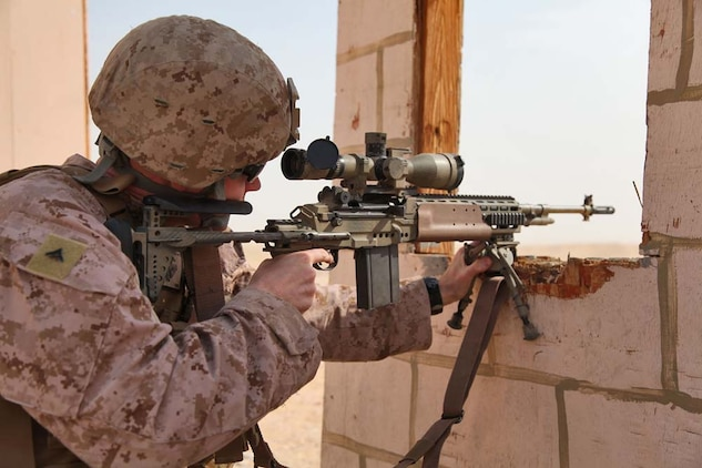 Lance Cpl. Matthew Long, scout sniper, Scout Sniper Platoon, Weapons Company, Battalion Landing Team 3/5, 15th Marine Expeditionary Unit, fires a M39 enhanced marksmanship rifle at a marksmanship training event near Camp Buehring during Exercise Eager Mace 13, Nov. 12. The U.S. Navy and Marine Corps participated in the bilateral training exercise with the Kuwait Armed Forces Nov. 11-21. The purpose of the exercise was to expand levels of cooperation, enhance mutual maritime capabilities, as well as promote long-term regional stability and interoperability between U.S. forces and regional partners. The 15th MEU is deployed as part of the Peleliu Amphibious Ready Group as a theater reserve and crisis response force throughout U.S. Central Command and the U.S. 5th Fleet area of responsibility. Long, 27, is from Kilgore, Texas. (U.S. Marine Corps photo by Cpl. Timothy Childers/Released)