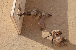 A U.S. Marine from Scout Sniper Platoon, Weapons Company, Battalion Landing Team 3/5, 15th Marine Expeditionary Unit, fires a semi-automatic sniper system at a marksmanship training event near Camp Buehring during Exercise Eager Mace 13, Nov. 12. The U.S. Navy and Marine Corps participated in the bilateral training exercise with the Kuwait Armed Forces Nov. 11-21. The purpose of the exercise was to expand levels of cooperation, enhance mutual maritime capabilities, as well as promote long-term regional stability and interoperability between U.S. forces and regional partners. The 15th MEU is deployed as part of the Peleliu Amphibious Ready Group as a theater reserve and crisis response force throughout U.S. Central Command and the U.S. 5th Fleet area of responsibility. (U.S. Marine Corps photo by Cpl. Timothy Childers/Released)