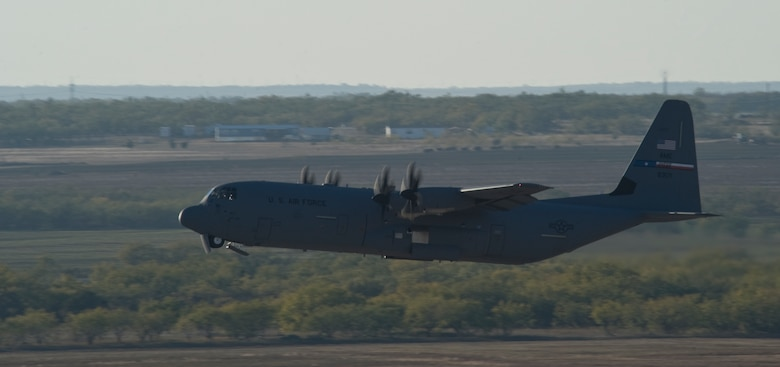 A C-130J assigned to the 317th Airlift Group takes off during a training exercise Nov. 30, 2012, at Dyess Air Force Base, Texas. The C-130J incorporates state-of-the-art technology to reduce manpower requirements, lower operating and support costs, and provides life-cycle cost savings over earlier C-130 models. Compared to older C-130s, the J model climbs faster and higher, flies farther at a higher cruise speed, and takes off and lands in a shorter distance. Dyess has received 23 J models and is scheduled to get a total of 28, making it the largest C-130J unit in the world. (U.S. Air Force photo by Staff Sgt. Richard P. Ebensberger/ Released)