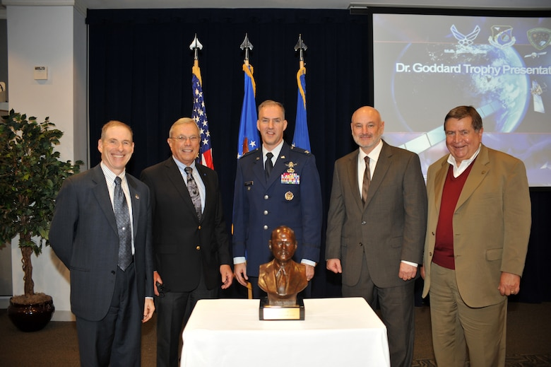 Members, past and present, of the Global Positioning Systems Directorate (GPS) stand behind the Dr. Robert  H. Goddard Memorial Trophy, which was awarded to the GPS Directorate in a ceremony held at Los Angeles Air Force Base in El Segundo, Calif. on November 30th, 2012.  From left to right are Mr. Douglas L. Loverro, Executive Director, Space and Missile Systems Center (SMC); Dr. Bradford W. Parkinson, Chief Architect for GPS in 1973;  U.S. Colonel Bernie J. Gruber, current Commander, GPS Directorate; David W. Madden, current Director, Military Satellite Communications  Systems Directorate at SMC and GPS Wing commander 2007 to 2010; and U.S Air Force (Retired) Colonel Gaylord Green, GPS Program Director from 1985 to 1988.   The Dr. Robert  H. Goddard Memorial Trophy is presented annually by the National Space Club to recognize significant contributions to United States leadership in the field of rocketry and astronautics.  Past winners of the Dr. Robert  H. Goddard Memorial Trophy include Presidents Ronald Reagan and Lyndon Johnson, Dr. Sheila Widnall, Dr. Charles Draper, the Apollo 11 astronauts, John Glenn (twice), and the crew who perished in the Space Shuttle Columbia disaster.  (U.S. Air Force photo by Sarah Corrice.)