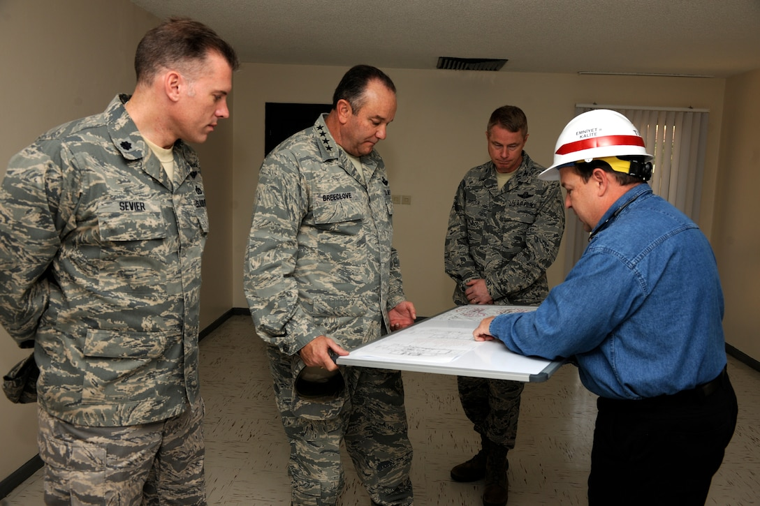 Gen. Philip M. Breedlove, U.S. Air Forces in Europe and U.S. Air Forces Africa commander, receives a briefing about the current base housing renovation project from Tommy Rose, U.S. Army Corps of Engineers, Nov. 29, 2012, at Incirlik Air Base, Turkey. The project will modernize more than 300 homes on base as part of a six-year housing construction initiative. (U.S. Air Force photo by Tech. Sgt. Dallas Edwards/ Released)