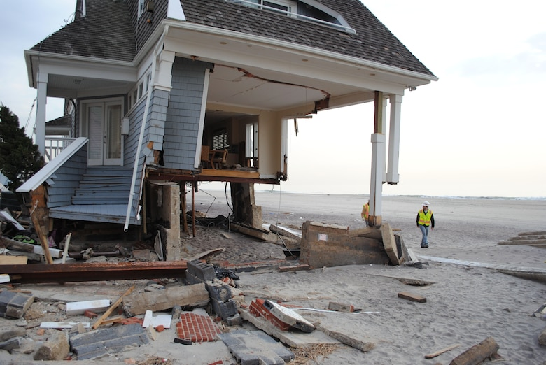 Jay Hershey, a debris engineer with the U.S. Army Corps of Engineers New York Recovery Field Office, inspects a house, devastated by last month's Hurricane Sandy, in Queens, N.Y., Nov. 30.