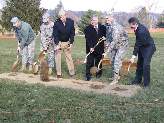 Leaders from the Defense Logistics Agency and U. S. Army Corps of Engineers break ground for the new DLA headquarters building at the Defense Distribution Susquehanna, Pa., on Nov. 28. They include (from left) Col. David Touzinsky, commander, Defense Distribution Susquehanna; Army Brig. Gen. Susan Davidson, Commanding General, DLA Distribution Center; Vice Adm. Mark Harnitchek, Director, Defense Logistics Agency; William Budden, Senior Executive Service, deputy commander; Col. Kent Savre, commander, U.S. Army Corps of Engineers, North Atlantic Division, and Rob Montefour, DLA Installation Support site director.