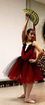 A ballerina poses with Spanish flair during the Tarawa Terrace Community Center Holiday Tree Lighting Ceremony at the Marine Corps Base Camp Lejeune housing community center Dec. 1. Young dancers from the community center's Dance With Me Academy provided entertainment for the event's patrons throughout the evening.