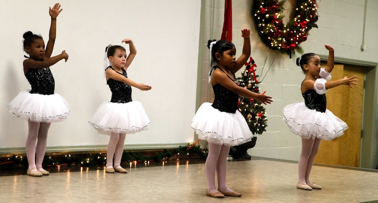 Four little ballerinas perform during the Tarawa Terrace Community Center Holiday Tree Lighting Ceremony at the Marine Corps Base Camp Lejeune housing community center Dec. 1. Young dancers from the community center's Dance With Me Academy provided entertainment for the event's patrons throughout the evening.