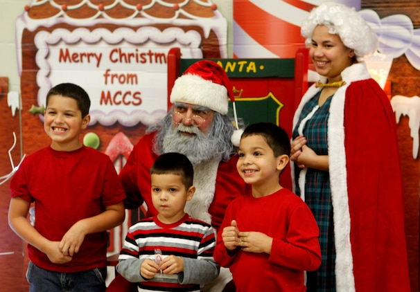 Santa and Mrs. Claus pose for a picture with three children during the Tarawa Terrace Community Center Holiday Tree Lighting Ceremony at the Marine Corps Base Camp Lejeune housing community center Dec. 1. As usual, Santa was a huge hit at the event as people waited in long lines to get a picture with him.