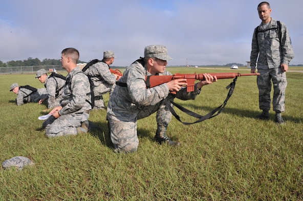 Officer Training School trainees participate in a BELPS exercise during their third week of training at Maxwell Air Force Base, Oct. 3. This exercise required trainees to move as a group without verbally communicating. (U.S. Air Force photo by Airman 1st Class William Blankenship)