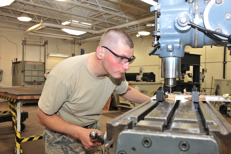 U.S. Air Force Airman 1st Class Donovan Timek, 355th Equipment Maintenance Squadron aircraft metals technology journeyman, is pocket milling on Davis-Monthan Air Force Base, Ariz., Nov 29, 2012. Pocket milling is removing all the material inside some arbitrary closed boundary on a flat surface of a work piece to a fixed depth (U.S. Air Force Photo by Airman 1st Class Josh Slavin/Released)