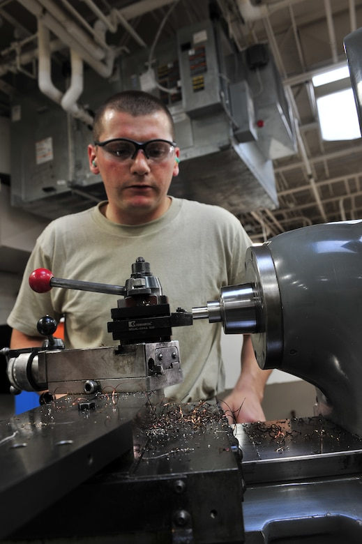 U.S. Air Force Airman 1st Class Donovan Timek, 355th Equipment Maintenance Squadron aircraft metals technology journeyman, turns a piece of stainless steel on a lathe on Davis-Monthan Air Force Base, Ariz., Nov 27, 2012. The Lathe can accurately get you within a thousandth of an inch of your final measurement; this is good for making a bushing. (U.S. Air Force Photo by Airman 1st Class Josh Slavin/Released)