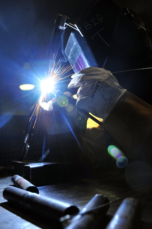 U.S. Air Force Airman 1st Class Donovan Timek, 355th Equipment Maintenance Squadron aircraft metals technology journeyman, is tungsten inert gas arc welding in the G6 position on Davis-Monthan Air Force Base, Ariz., Nov 27, 2012.  Airman Timek is practicing this technique to be weld certified in Air Force Metals Tech Standards. (U.S. Air Force Photo by Airman 1st Class Josh Slavin/Released)