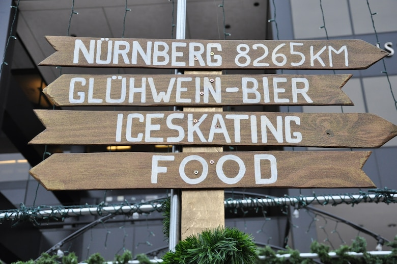 DENVER – A directional sign points people in the direction of drinks, ice skating, food and Nurnberg, Germany, Nov. 28, 2012, at the 12th annual Denver Christkindl Market scheduled to run through Dec. 22 in Skyline Park. From ice skating to traditional German cuisine, the market offers an abundance of activities and sights for those looking for something to do. (U.S. Air Force photo by Staff Sgt. Kali L. Gradishar)