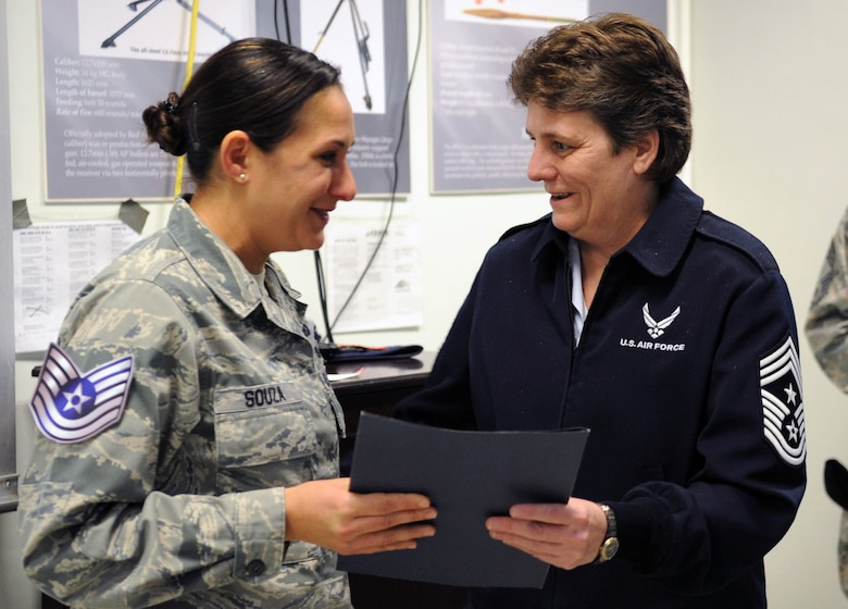 Chief Master Sgt. Nancy Judge, 39th ABW command chief, presents now Tech. Sgt. Julia Souza, 39th Security Forces Squadron, with her Stripes for Exceptional Performers promotion certificate Dec. 3, 2012, at Incirlik Air Base, Turkey.  Souza was officially promoted to technical sergeant Dec. 1. STEP is an incentive program that immediately promotes outstanding senior airmen, staff and technical sergeants and is based on the Airman's professional accomplishments and recommendations from their commander. (U.S. Air Force photo by Senior Airman Daniel Phelps/Released)