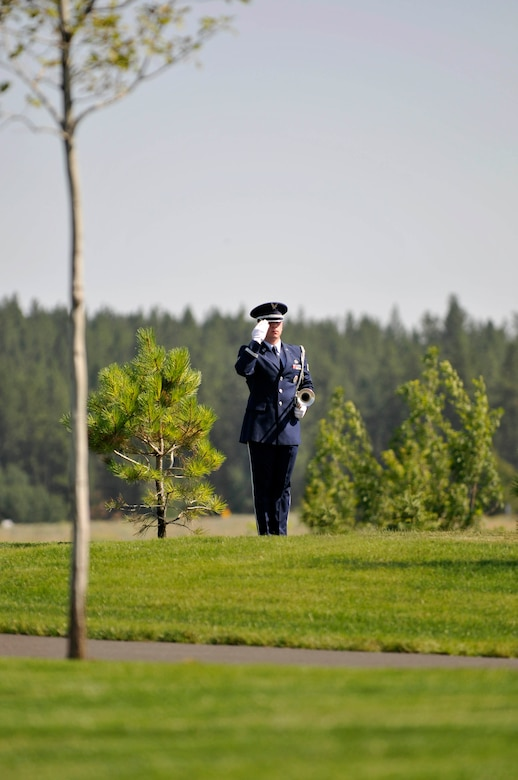 Staff Sgt. Richard Hatch, 141st Air Refueling Wing band member, renders a salute during a ceremony at the Washington State Veterans Cemetery, Medical Lake Washington, July 30, 2012. (U.S. Air Force photo by Master Sgt. Michael Stewart/Released)