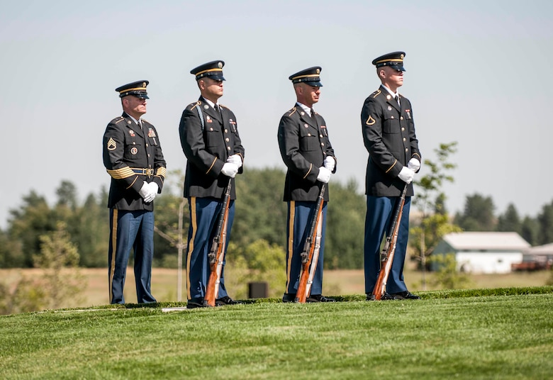 Soldiers from the Washington Army National Guard position themselves for the start of the military honors ceremony held for a fallen Airman at the Washington State Veterans Cemetary in Medical Lake July 30, 2012. (U.S. Air Force photo by Master Sgt. Michael Stewart/Released)