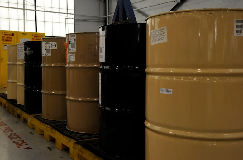 Barrels of gasoline, oil and grease sit in the Aerospace Ground Equipment flight hazardous materials storage on Barksdale Air Force Base, La., Dec. 4. The production control section has the responsibility of monitoring, distributing and disposing of these chemicals for the AGE flight. (U.S. Air Force photo/Airman 1st Class Andrew Moua)(RELEASED)