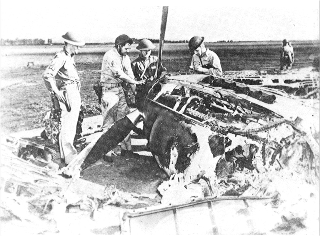 Resourceful aircrews remove parts from a P-40 destroyed in the Dec. 7, 1941 attack on Wheeler Air Base for us on other repairable aircraft.