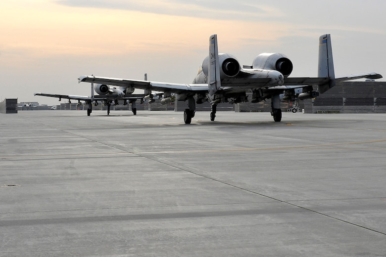 "A-10 Thunderbolt II's taxi to their parking spots after a close air support mission at Bagram Airfield, Afghanistan, Nov. 27, 2012. The A-10 is part of a squadron of ""Warthogs"" that recently arrived from Davis-Monthan Air Force Base, Az., to fly missions in support of American and coalition forces here in Afghanistan. (U.S. Air Force photo/Senior Airman Chris Willis)"
