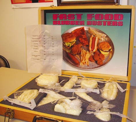 A Fast Food Blubber Busters case displays the fat content of most known fast food items. Naval Branch Health Clinic Albany officials encourage individuals to eat healthy during the holidays.