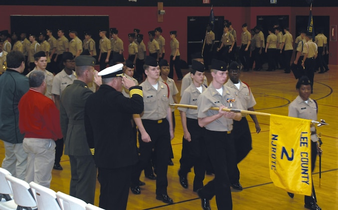 Maj. Mike Mullins, deputy manager, Center Operations Division, Maintenance Management Center, Marine Corps Logistics Command, serves as the guest inspector during Lee County High School Navy Junior Reserve Officers Training Corps' annual inspection, Nov. 30. Mullins participated in a pass in review during the inspection.