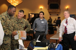 Master Gunnery Sgt. Antoine M. Brown, the communications chief for 1st Marine Logistics Group, and Col. Randy J. Lawson, chief of staff for 1st MLG, seek knowledge on some of the world's latest technology during the semi-annual Technology Expo at the Pacific Views Event Center here, Dec. 6.