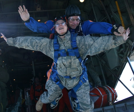Public affairs officer, Capt. Cathleen Snow, 920th Rescue Wing, skydives with a Canadian jump master during a U.S., Canadian Search and Rescue Excersise in Summerside, Prince Edward Island, Canada. (Courtesy photo)