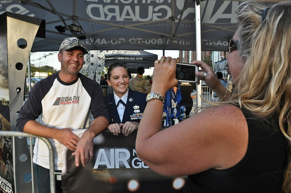 Wisconsin Air National Guardsman Staff Sgt. Leah Rogers and her husband, Chris, pose for a photograph at the Air National Guard's recruiting booth at Miller Park in Milwaukee Wed., Sept. 12, 2012.  Chris Rogers also serves with the 128th as Quality Assurance Inspector in the Maintenance Squadron and holds the rank of technical sergeant.  Rogers was at Miller Park to throw out the ceremonial first pitch before the Brewers' game against the Atlanta Braves. (Air National Guard Photo by Staff Sgt. Christopher Wenzel / Released)