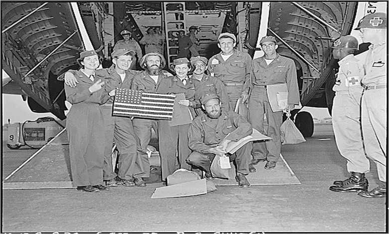 Maj. David MacGhee, grandfather-in-law of Lt. Col. Chadwick Igl, kneeling in front, repatriated in an UN POW exchange.  He was in the first B-29 shot down during the Korean War and was a POW for almost the entire war. To survive and remain resilient, MacGhee practice the four pillars of wellness we do today.  (Courtesy Photo)
