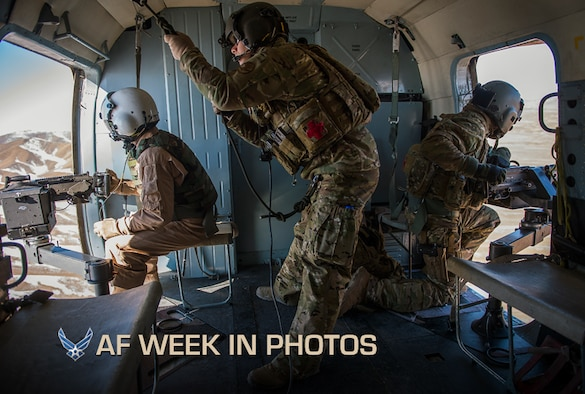 """Tech. Sgt. Will Stimpson, center, and Staff Sgt. Michael Dinicola, right, evaluate Afghan air force Sgt. Razeg, as he provides over watch during a mission on a Mi-17 helicopter from Kabul, Afghanistan, Nov. 29, 2012. The flight was a """"check ride"""" mission, allowing an Afghan air force copilot and gunner to further train and qualify in their respective jobs. (U.S. Air Force photo/Tech. Sgt. Dennis J. Henry Jr.)"""