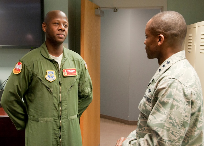 PEASE AIR NATIONAL GUARD BASE, N.H. -- Lt. Gen. Darren McDew, 18th Air Force commander, speaks with Tech. Sgt. Ron McKinney during a visit to the the 157th Operations Group Dec. 4. The general visited here to meet with Airmen and see first-hand the impact Total Force Integration is having on the mission of the New Hampshire Air National Guard. (National Guard photo by Tech. Sgt. Mark Wyatt/RELEASED)