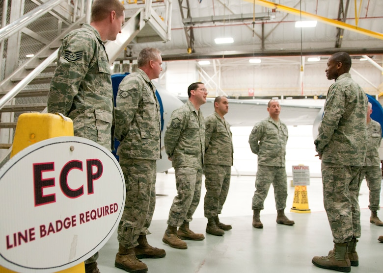 PEASE AIR NATIONAL GUARD BASE, Mass. -- Lt. Gen. Darren McDew, 18th Air Force commander, speaks with members of the 157th Maintenance Group during a visit to the hanger Dec. 4. The general visited here to meet with Airmen and see first-hand the impact Total Force Integration is having on the mission of the New Hampshire Air National Guard. (National Guard photo by Tech. Sgt. Mark Wyatt/RELEASED)
