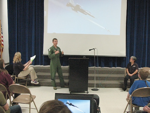 U.S. Air Force Capt. Bryan Brandon, 388th Fighter Wing Pilot, addresses the crowd at the South Clearfield Elementary School on Nov. 30 as part of the Hill Starbase Academy Graduation Ceremony. ((U.S. Air Force photo by Mary Lou Gorny/Released).