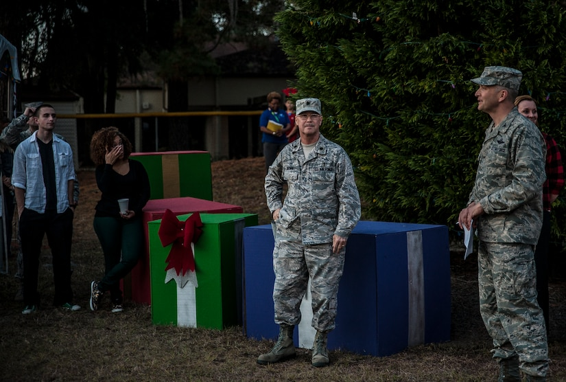 Col. Darren Hartford, 437th Airlift Wing commander, gives his remarks at the 2012 Joint Base Charleston – Air Base Tree Lighting ceremony Dec. 5, 2012. Shortly after his remarks, Hartford had Madison, age 4, and daughter of Lt. Col. Craig Burton, 628th Air Base Wing judge advocate, light the tree. (U.S. Air Force photo/ Senior Airman Dennis Sloan)