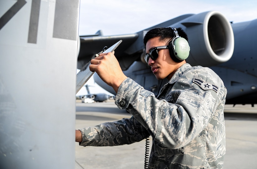 Airman 1st Class Justin Locsin, 437th Aircraft Maintenance Squadron crew chief, starts up an external power source for a C-17 Globemaster III Dec. 5, 2012, at Joint Base Charleston - Air Base, S.C. After flight, maintenance crew chiefs ensure the aircraft remains operationally ready. (U.S. Air Force photo/Staff Sgt. Rasheen Douglas)