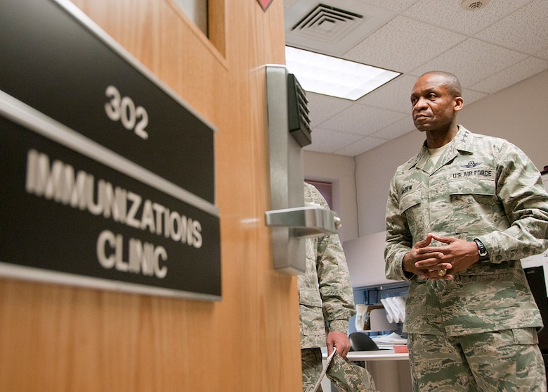 PEASE AIR NATIONAL GUARD BASE, Mass. -- Lt. Gen. Darren McDew, 18th Air Force commander, visits the Immunizations Clinic during a visit to 157th Medical Group Dec. 4. The general visited here to meet with Airmen and see first-hand the impact Total Force Integration is having on the mission of the New Hampshire Air National Guard. (National Guard photo by Tech. Sgt. Mark Wyatt/RELEASED)