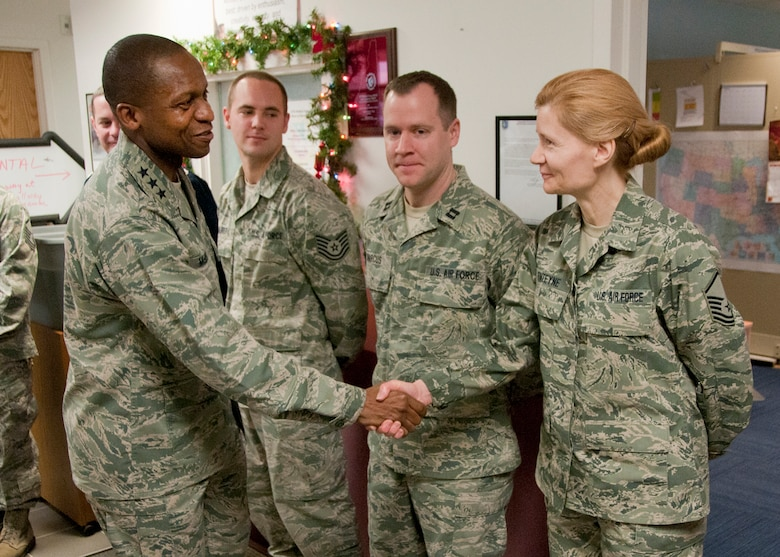 PEASE AIR NATIONAL GUARD BASE, Mass. -- Lt. Gen. Darren McDew, 18th Air Force commander, greets Master Sgt. June Fonteyne and Capt. Paul Marcus among others during a visit to the 157th Medical Group Dec. 4. The 18th Air Force commander visited here to meet with Airmen and see first-hand the impact Total Force Integration is having on the mission of the New Hampshire Air National Guard. (National Guard photo by Tech. Sgt. Mark Wyatt/RELEASED)