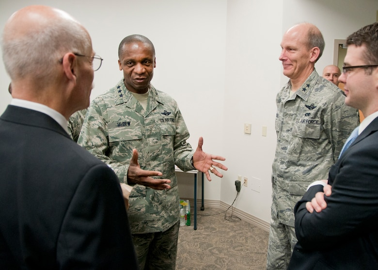 PEASE AIR NATIONAL GUARD BASE, Mass. -- Lt. Gen. Darren McDew, 18th Air Force commander, and Maj. Gen. William N. Reddel, The Adjutant General, New Hampshire, welcome congressional staff members (left) Steve Monier and Patrick Day to a 157th Air Refueling Wing mission briefing during a visit to Building 100 Dec. 4. The 18th Air Force commander visited here to meet with Airmen and see first-hand the impact Total Force Integration is having on the mission of the New Hampshire Air National Guard. (National Guard photo by Tech. Sgt. Mark Wyatt/RELEASED)