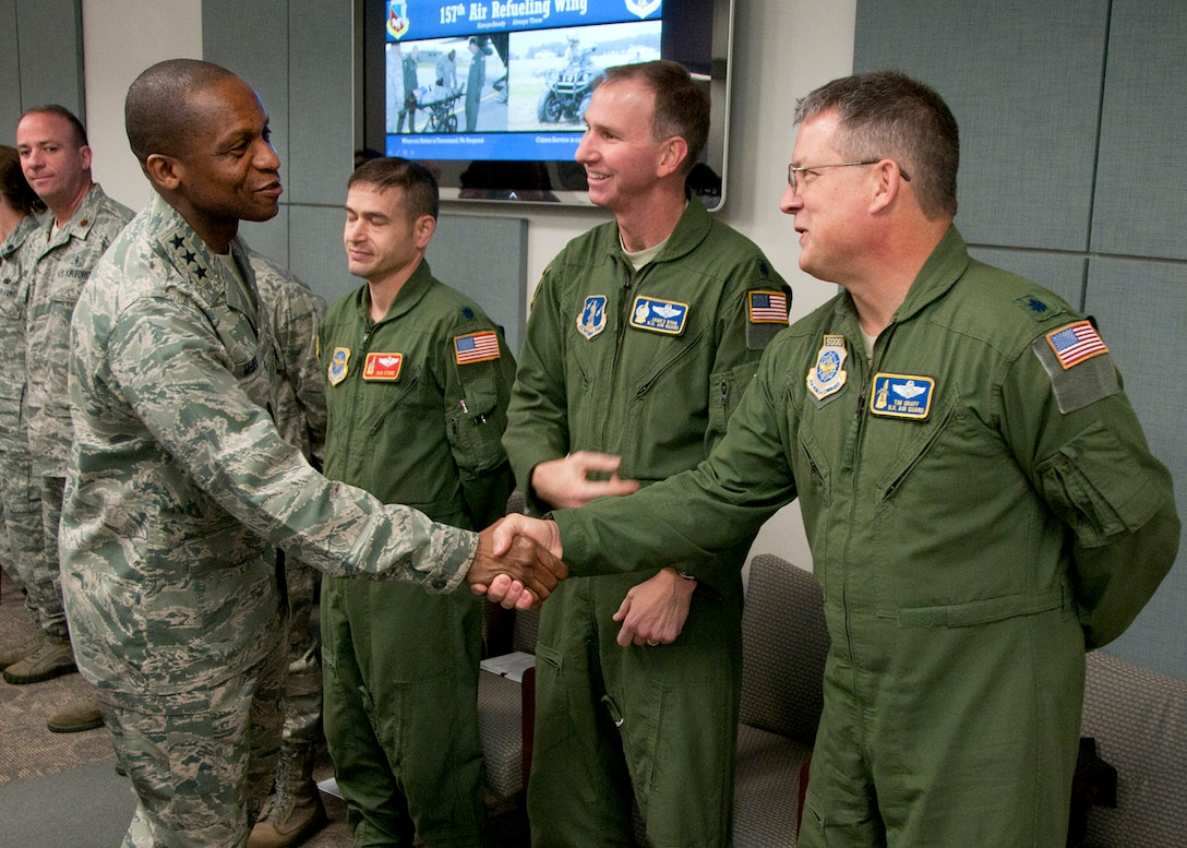 PEASE AIR NATIONAL GUARD BASE, Mass. -- Lt. Gen. Darren McDew, 18th Air Force commander, greets Lt. Col. James Ryan and Lt. Col. Tim Graff among others during a visit to Building 100 Dec. 4. The general visited here to meet with Airmen and see first-hand the impact Total Force Integration is having on the mission of the New Hampshire Air National Guard. (National Guard photo by Tech. Sgt. Mark Wyatt/RELEASED)