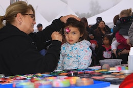 Aliana R. Alanis, 2, gets her face painted during the 2012 Trees for Troops event here Dec. 7.