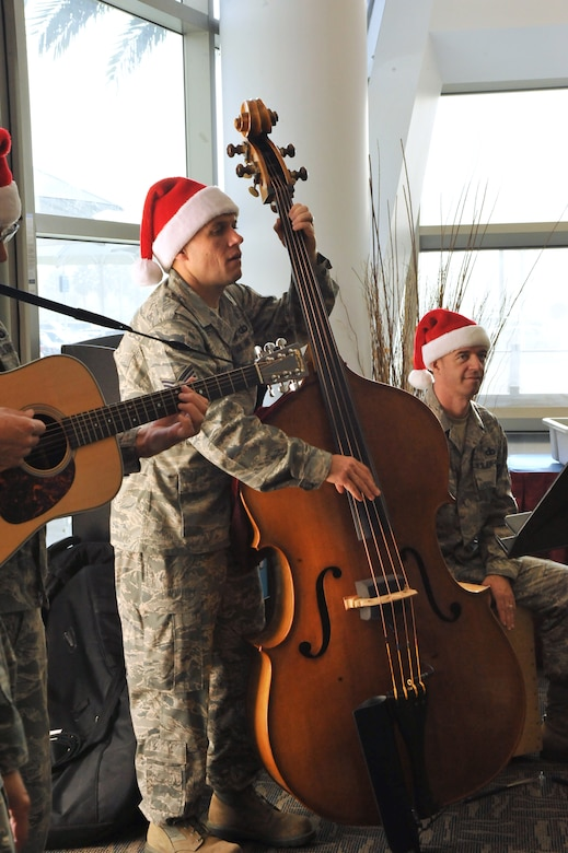 Holiday carolers from the Band of the Golden West perform at the Los Angeles AFB Club during the group's annual holiday tour of installations in their operating area, Dec. 7. (Photo by Sarah Corrice)