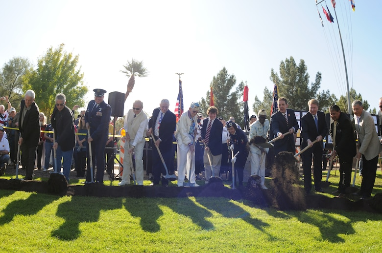 Col. Gary D. Brewer Jr., Commander of 161st Air Refueling Wing, joined Arizona Secretary of State Ken Bennett and other community leaders in the groundbreaking ceremony Dec. 7, 2012, of the Guns to Salute the Fallen World War II Memorial, at Wesley Bolin Memorial Park in Phoenix. (U.S. Air Force photo by Tech. Sgt. Susan Gladstein/Released)