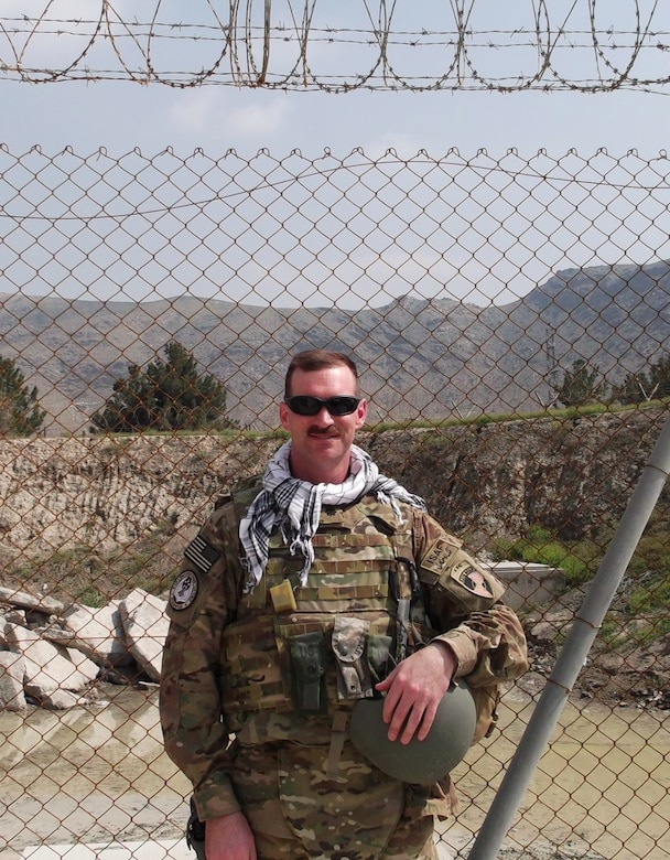 KABUL, Afghanistan -- Lt. Col. James Burleigh, 24th Air Force Operations director of current operations, served as the Expeditionary Cyber Support Element - Afghanistan deputy officer in charge and computer network operations planner for six months. He was the mission commander for more than 5,000 cyber operations and was awarded the Bronze Star Medal and the U.S. Army Combat Action Badge for his accomplishments down range during a ceremony Sept. 24th. (Courtesy photo)