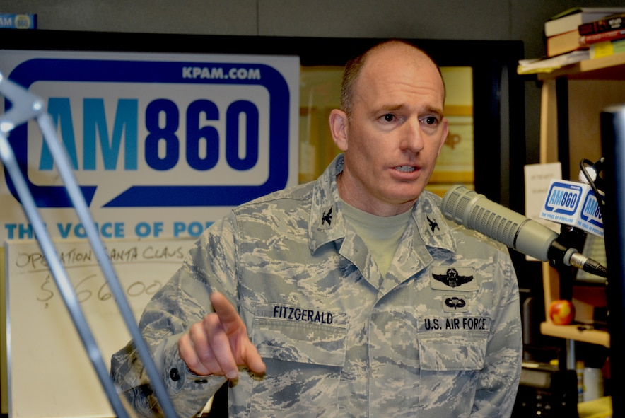 Oregon Air National Guard Col. Paul Fitzgerald, 142nd Fighter Wing Mission Support Commander, answers questions during the Operation Santa Claus fund raising event held on the Bob Miller Show, Nov. 30, 2012 here in Portland, Ore. (U.S. Air Force photo by Tech. Sgt. Emily Thompson, 142nd Fighter Wing Public Affairs/Released)